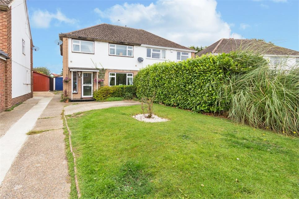 Three bedroom semi-detached family house situated on generous plot within sought-after road and offered as well presented